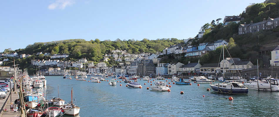 Looe with its sandy family beach and fishing and boat trips is a popular day out